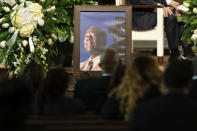 """A photograph of Henry """"Hank"""" Aaron, longtime Atlanta Braves player and Hall of Famer, sits outside his casket during his funeral on Wednesday, Jan. 27, 2021 at Friendship Baptist Church in Atlanta. (Kevin D. Liles/Atlanta Braves via AP, Pool)"""