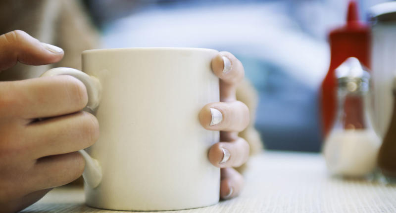 A Florida teacher has shared a hilarious misunderstanding she had with her class. Pictured is a stock image of a woman's hands around a coffee cup.