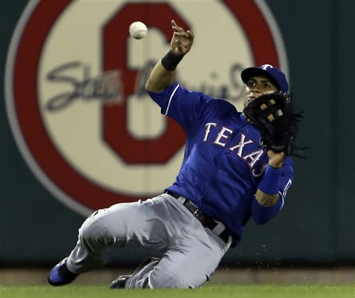 Texas Rangers center fielder Leonys Martin slides and catches a ball hit by St. Louis Cardinals' Carlos Beltran to end the fifth inning of a baseball game on Saturday, June 22, 2013, in St. Louis. (AP Photo/Jeff Roberson)