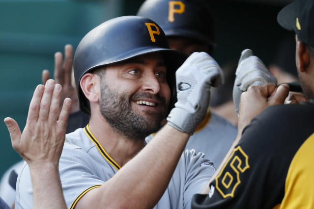 Pittsburgh Pirates' Francisco Cervelli celebrates in the dugout after hitting a two-run home run off Cincinnati Reds starting pitcher Homer Bailey during the first inning of a baseball game Wednesday, May 23, 2018, in Cincinnati. (AP Photo/John Minchillo)