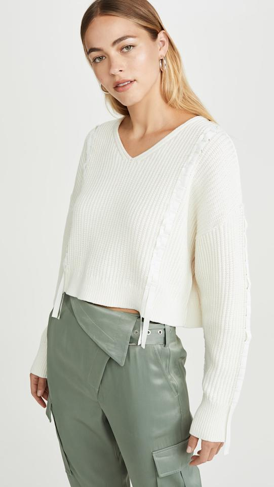 "<p>We love the little unique details on this <a href=""https://www.popsugar.com/buy/31-Phillip-Lim-Cropped-Ribbon-Weave-Sweater-493895?p_name=3.1%20Phillip%20Lim%20Cropped%20Ribbon%20Weave%20Sweater&retailer=shopbop.com&pid=493895&price=395&evar1=fab%3Aus&evar9=45816436&evar98=https%3A%2F%2Fwww.popsugar.com%2Ffashion%2Fphoto-gallery%2F45816436%2Fimage%2F46673262%2F31-Phillip-Lim-Cropped-Ribbon-Weave-Sweater&list1=shopping%2Csweaters%2Cspring%2Ccrop%20tops%2Cspring%20fashion&prop13=mobile&pdata=1"" rel=""nofollow"" data-shoppable-link=""1"" target=""_blank"" class=""ga-track"" data-ga-category=""Related"" data-ga-label=""https://www.shopbop.com/cropped-ribbon-weave-sweater-31/vp/v=1/1526967571.htm?fm=search-viewall-shopbysize&amp;os=false"" data-ga-action=""In-Line Links"">3.1 Phillip Lim Cropped Ribbon Weave Sweater</a> ($395).</p>"