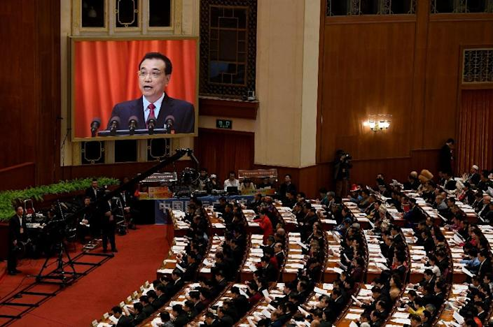 Chinese Premier Li Keqiang announces a trimmed 2017 GDP growth target of around 6.5 percent (AFP Photo/GREG BAKER)