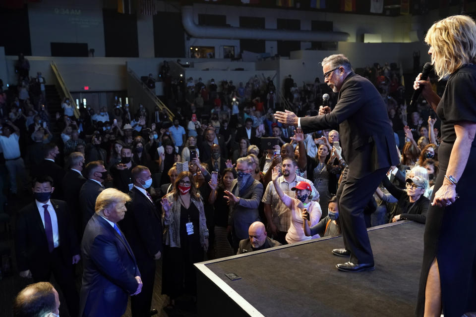 FILE - In this Sunday, Oct. 18, 2020, file photo, President Donald Trump, lower left, attends church at International Church of Las Vegas, as Pastor Pasqual Urrabazo, second from the right, gestures on stage in Las Vegas, Nev. (AP Photo/Alex Brandon, File)