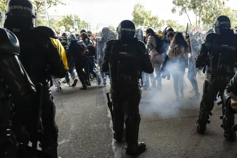 Riot police fire tear gas to disperse demonstrators in Bogota during a nationwide strike (AFP Photo/JUAN BARRETO                        )
