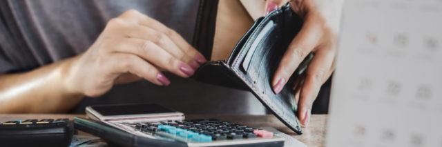woman hand open empty purse looking for money for credit card debt, bankrupt concept