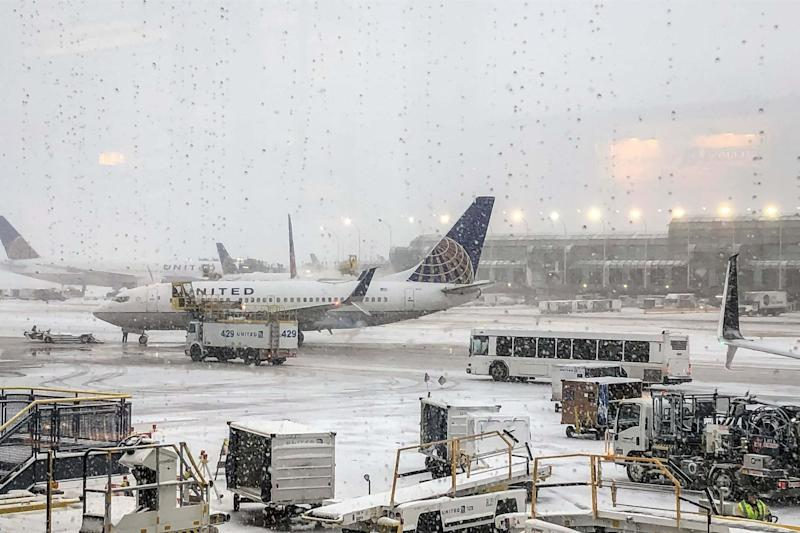 Snow falls at O'Hare Airport in Chicago: AP