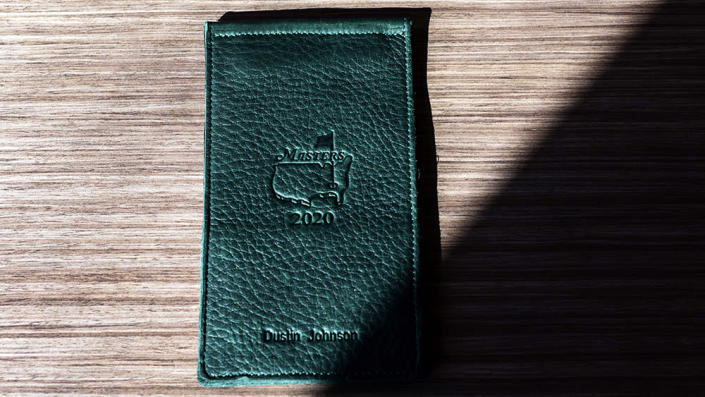 A yardage book holder from the 2020 Masters, which Johnson won. - Credit: Saul Martinez