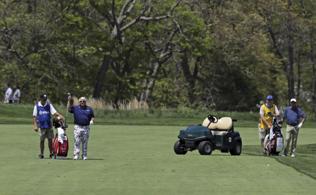 John Daly prepares to hit off the 11th fairway during the first round of the PGA Championship golf tournament, Thursday, May 16, 2019, at Bethpage Black in Farmingdale, N.Y. (AP Photo/Charles Krupa)