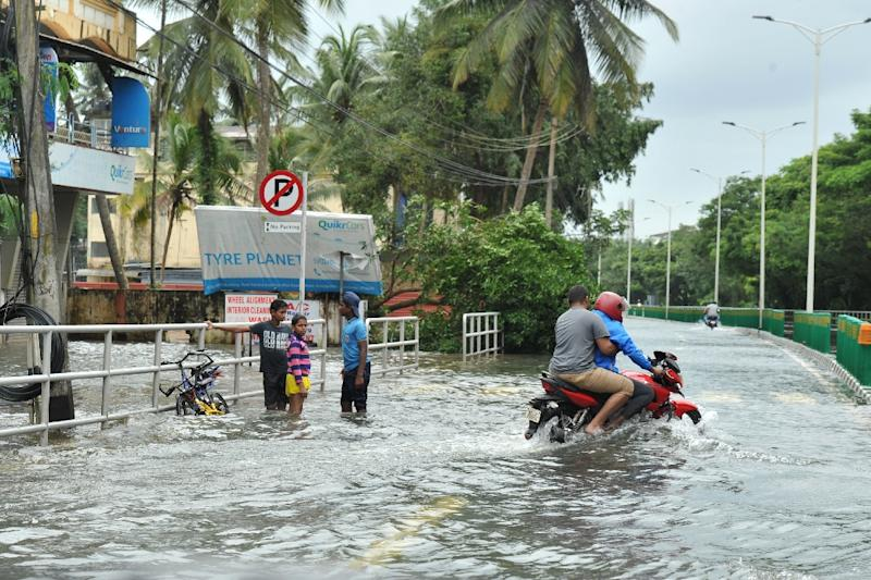 Rain abates in India's flood-hit Kerala, fears of disease in camps