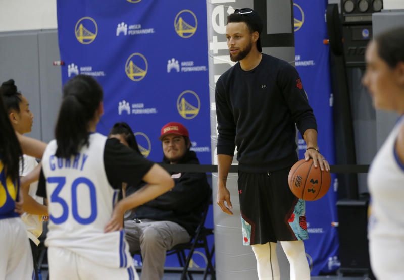 OAKLAND, CA - AUGUST 12: Golden State Warriors' Stephen Curry watches from the sideline during the Warriors girl's basketball camp at the Rakuten Performance Center in Oakland, Calif., on Monday, August 12, 2019. (Photo by Jane Tyska/MediaNews Group/The Mercury News via Getty Images)