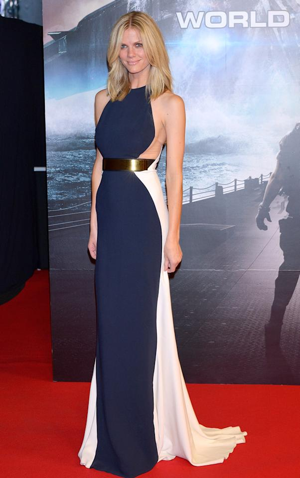 """Across the Pacific, Brooklyn Decker hit the red carpet for the Japanese premiere of <a target=""""_blank"""" href=""""http://movies.yahoo.com/movie/battleship-2012/"""">""""Battleship""""</a> at Tokyo's International Yoyogi complex. The model/actress -- <a target=""""_blank"""" href=""""http://omg.yahoo.com/blogs/runway/rihanna-struts-her-stuff-pajama-inspired-look-battleship-173428642.html"""">who's been besting co-star Rihanna in the fashion department</a> since their promo tour began -- once again killed it, this time in a stunning Stella McCartney gown, which featured a gold waistband and short train. (4/3/2012)"""