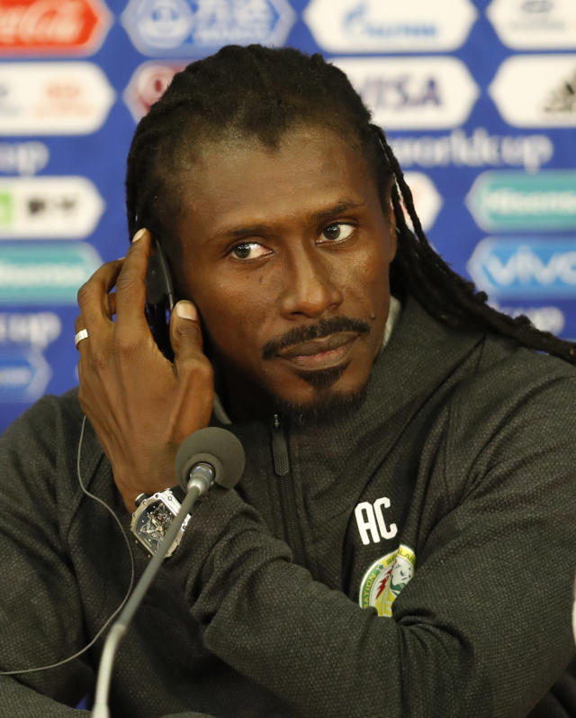Senegal coach Aliou Cisse attend a press conference before Senegal's official training on the eve of the group H match between Poland and Senegal at the 2018 soccer World Cup in the Spartak Stadium in Moscow, Russia, Monday, June 18, 2018. (AP Photo/Eduardo Verdugo)