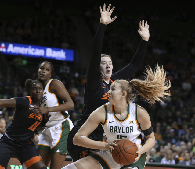 Baylor forward Lauren Cox, right, drives on Oklahoma State center Kassidy De Lapp, left, in the second half of an NCAA college basketball game, Sunday, Jan. 12, 2020, in Waco, Texas. (Rod Aydelotte/Waco Tribune Herald via AP)