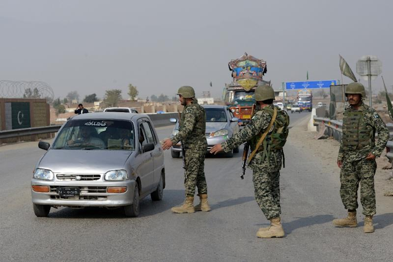 Pakistani paramilitary soldiers stop a vehicle at a security check point in Peshawar on February 17, 2017
