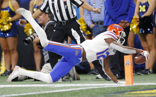 Florida wide receiver Van Jefferson (12) dives for the end zone coming up short against Michigan during the first half of the Peach Bowl NCAA college football game, Saturday, Dec. 29, 2018, in Atlanta. (AP Photo/John Bazemore)