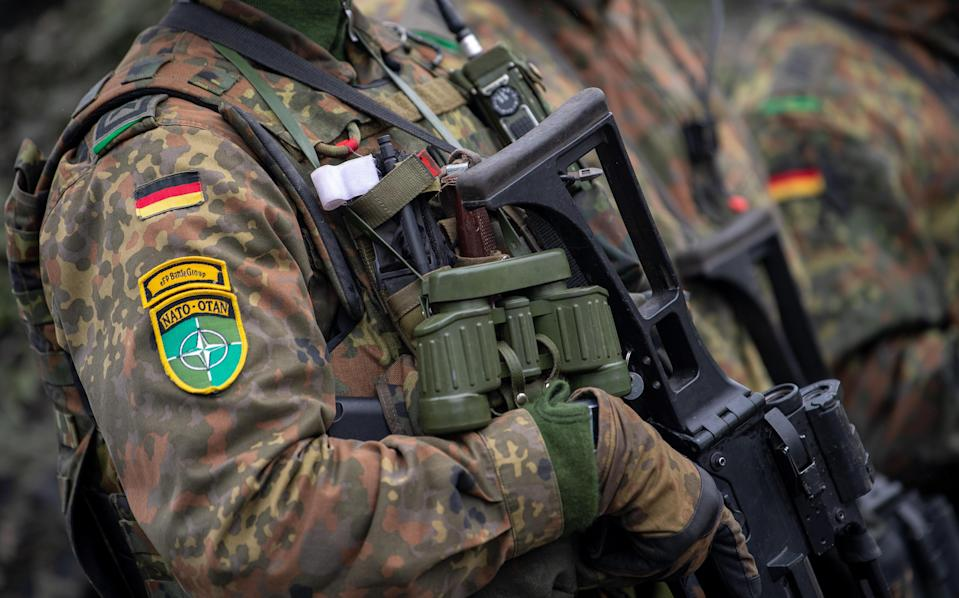 German soldiers of the Enhanced Forward Presence (eFP) Battle Group await a visit by the German Defence Minister in Rukla, Lithuania, October 10, 2019. / Credit: Monika Skolimowska/picture alliance/Getty