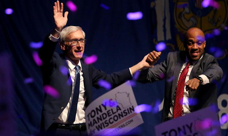 Evers, left, defeated Walker in the race for governor. (Photo: ASSOCIATED PRESS)