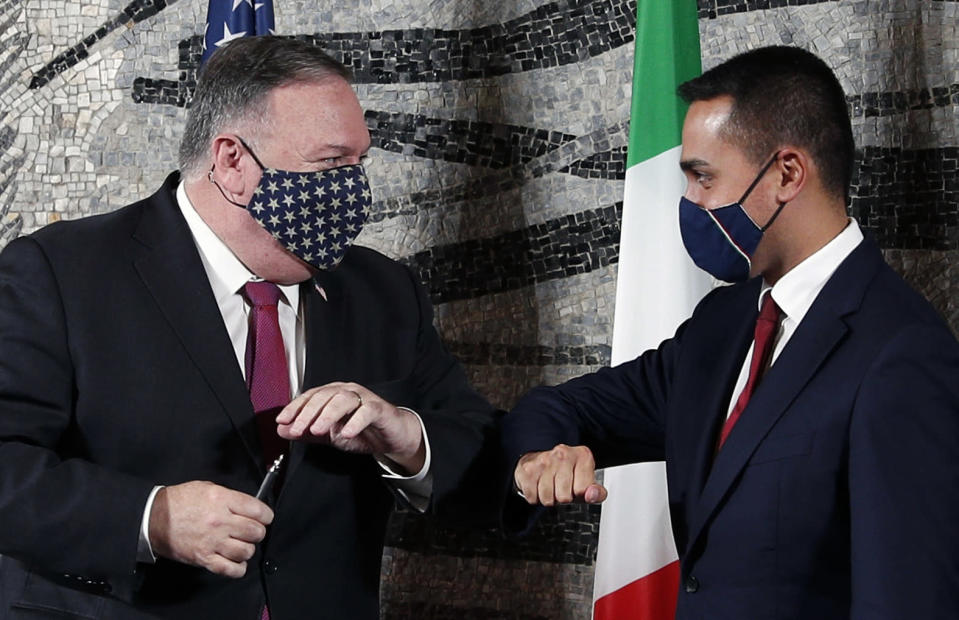 U.S. Secretary of State Mike Pompeo, left, bumps elbows with Italian Foreign Minister Luigi Di Maio in Rome, Wednesday, Sept. 30, 2020. Pompeo is in Italy as part of his six-day trip to Southern Europe. (Guglielmo Mangiapane/Pool Photo via AP)