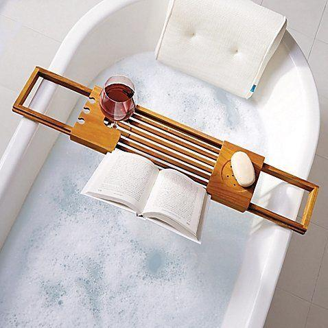 "<i>Buy it from <a href=""https://www.bedbathandbeyond.com/store/product/teak-bathtub-caddy/1042031918?categoryId=13447"" target=""_blank"">Bed Bath & Beyond </a>for $39.99.</i>"