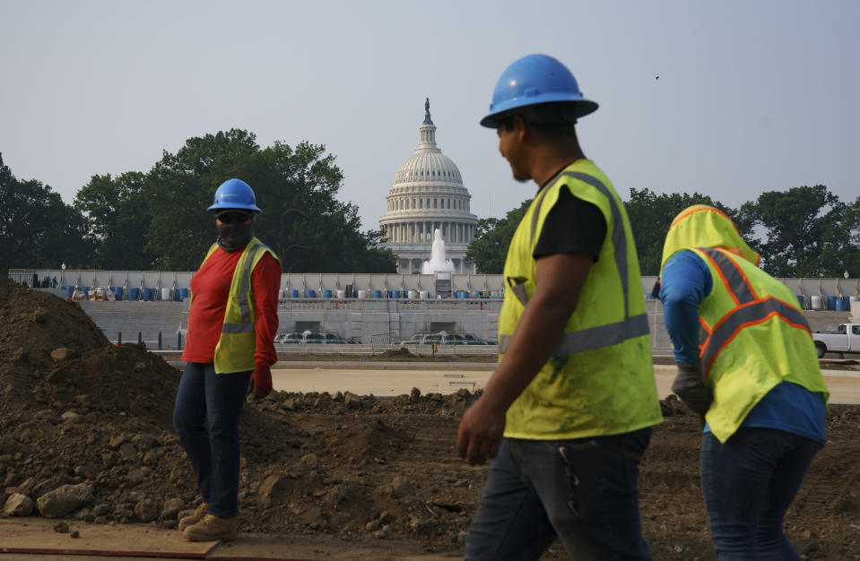 Workers repair a park near the Capitol in Washington, Wednesday, July 21, 2021. About 8 in 10 Americans favor plans to increase funding for roads, bridges and ports and for pipes that supply drinking water. But a new poll from The Associated Press-NORC Center for Public Affairs Research shows that's about as far as Democrats and Republicans intersect on infrastructure. P (AP Photo/J. Scott Applewhite)