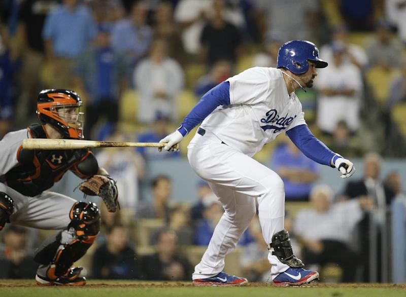 Los Angeles Dodgers' Adrian Gonzalez watches is walk-off single against the San Francisco Giants during the 10th inning of a baseball game on Thursday, Sept. 12, 2013, in Los Angeles. The Dodgers won 3-2. (AP Photo/Jae C. Hong)