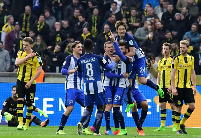 Hertha Berlin's Marvin Plattenhardt celebrates with teammates after scoring their second goal against Borussia Dortmund in Berlin, Germany, on March 11, 2017