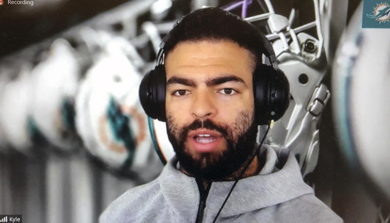 FILE - In this March 26, 2020, file photo, Miami Dolphins NFL football player Kyle Van Roy is shown during a Zoom news conference in this photo made in Miami Lakes, Fla. In a normal year, coaches would have greeted many of their team's players for the first time with a handshake Monday, April 6, 2020, for the start of the team's offseason workout program. But nothing is normal in the days of a global pandemic. (AP Photo/Steve Wine, Filre)