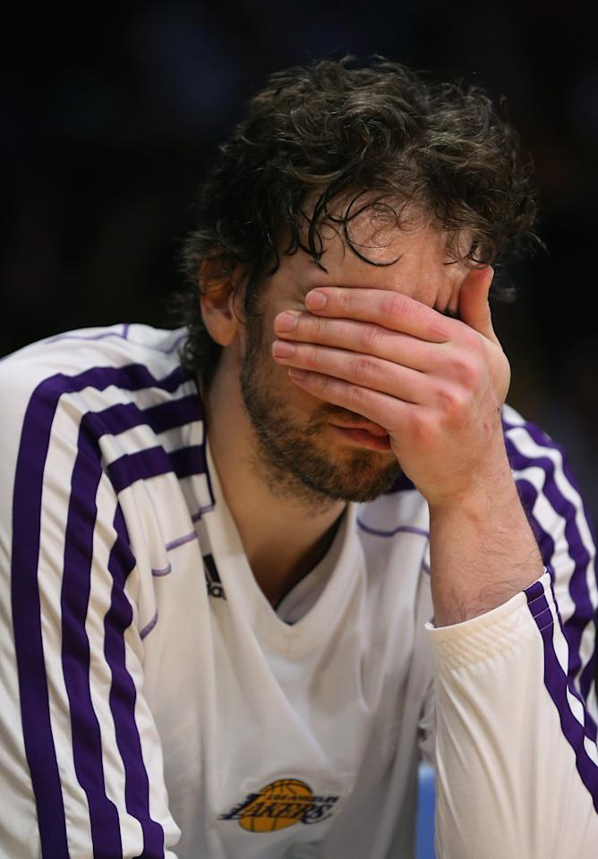 LOS ANGELES, CA - APRIL 28:  Pau Gasol #16 of the Los Angeles Lakers puts his hand on his face after coming out of the game in the second half against the San Antonio Spurs during Game Four of the Western Conference Quarterfinals of the 2013 NBA Playoffs at Staples Center on April 28, 2013 in Los Angeles, California. The Spurs defeated the Lakers 103-82. NOTE TO USER: User expressly acknowledges and agrees that, by downloading and or using this photograph, User is consenting to the terms and conditions of the Getty Images License Agreement.  (Photo by Jeff Gross/Getty Images)thx  (Photo by Jeff Gross/Getty Images)