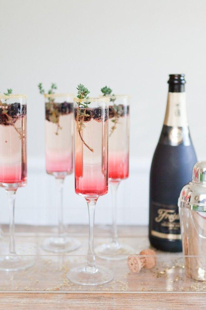 """<p>Nothing says chic like a bubbly ombré cocktail.</p><p>Get the recipe from <a href=""""http://theeffortlesschic.com/2013/the-table/cocktail-hour-blackberry-thyme-sparkler/"""" rel=""""nofollow noopener"""" target=""""_blank"""" data-ylk=""""slk:The Effortless Chic"""" class=""""link rapid-noclick-resp"""">The Effortless Chic</a>.</p>"""