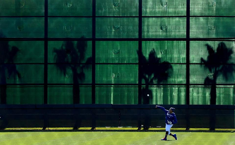 Dodgers outfielder Mookie Betts throws in the outfield