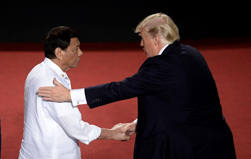 File Photo: Philippine President Rodrigo Duterte shakes hands with US President Donald Trump (R) during the 31st Association of Southeast Asian Nations (ASEAN) Summit in Cultural Center of the Philippines (CCP) in Manila on November 13, 2017. (Photo: NOEL CELIS/AFP via Getty Images)
