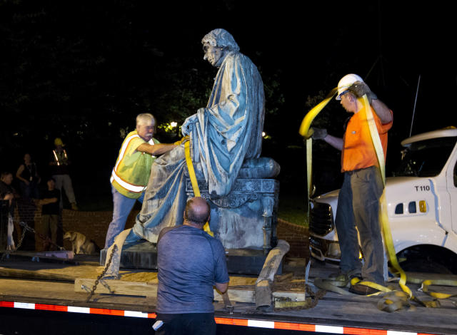 <p>Workers strap down the monument dedicated to U.S. Supreme Court Chief Justice Roger Brooke Taney on a flatbed truck after it was removed from outside the Maryland State House in Annapolis, Md., early Friday, Aug. 18, 2017. Maryland workers hauled several monuments away, days after a white nationalist rally in Charlottesville, Virginia, turned deadly. (Photo: Jose Luis Magana/AP) </p>