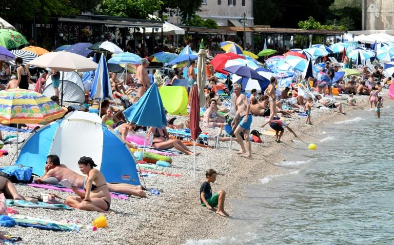 Croatia sees record virus cases as tourism takes toll