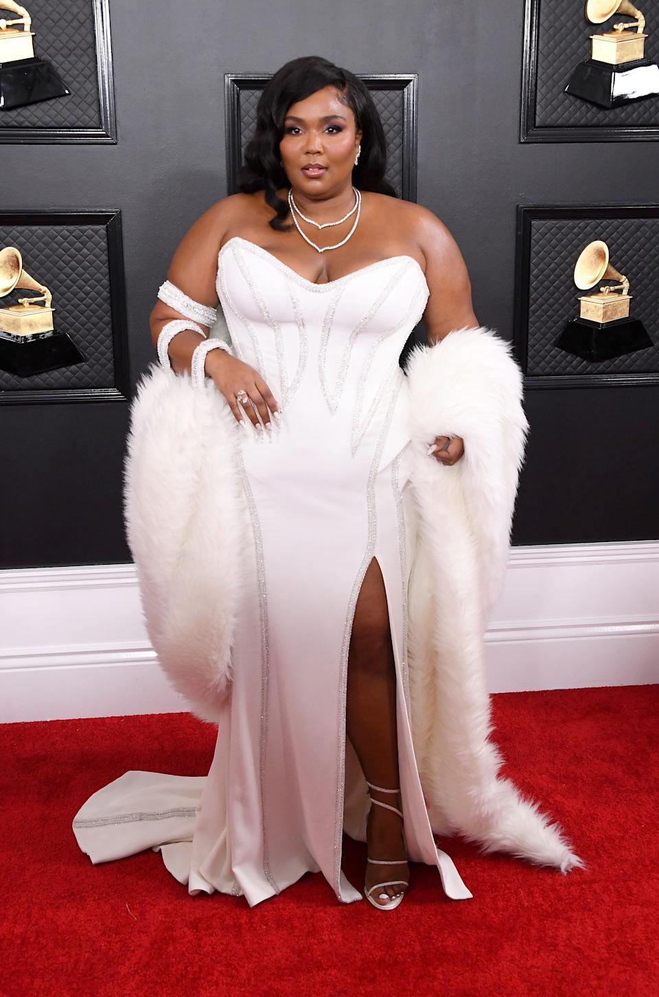 Come on, did you really think Lizzo would wear anything but an ultra-glam bedazzled Versace dress accessorized with fur?