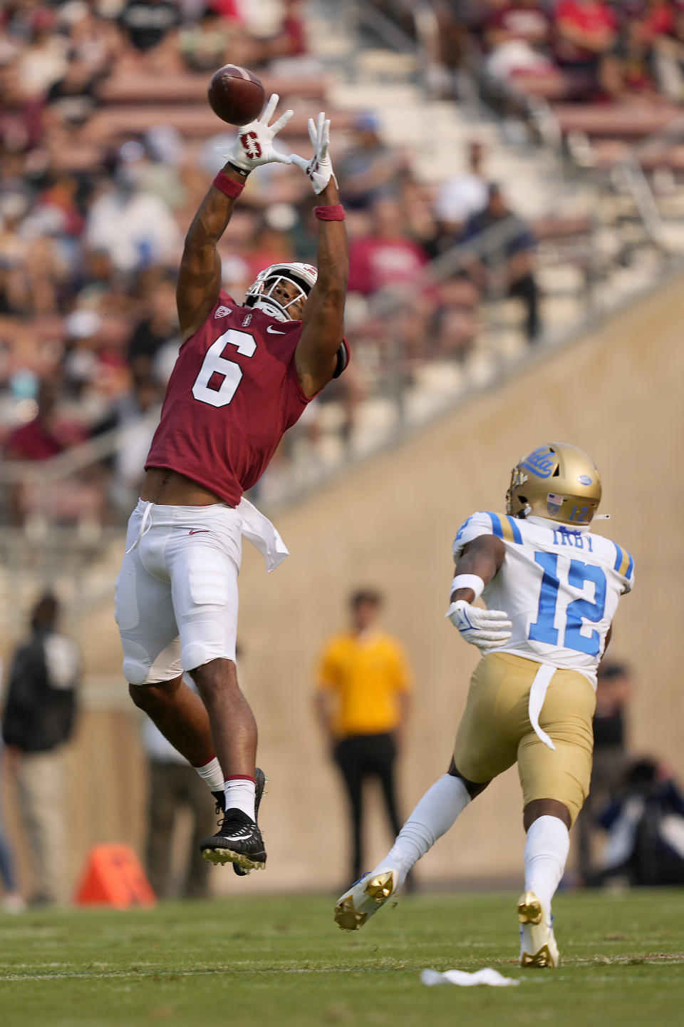 Stanford wide receiver Elijah Higgins (6) catches a pass over UCLA defensive back Martell Irby (12) during the first half of an NCAA college football game Saturday, Sept. 25, 2021, in Stanford, Calif. (AP Photo/Tony Avelar)