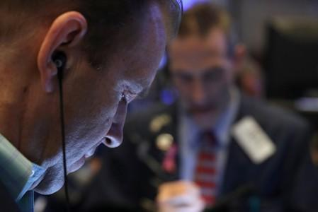 A trader works on the trading floor on the morning of the IPO for Chewy Inc. at the New York Stock Exchange (NYSE) in New York City