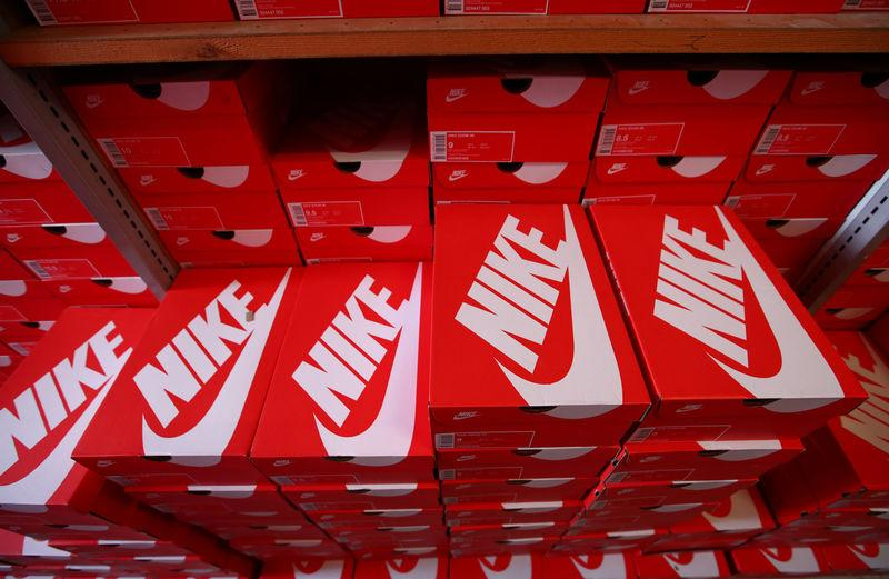 """Boxes of Nike shoes are pictured in the warehouse of local footwear retailer """"Pomp It Up"""" in Bussigny"""