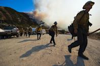 A crew prepares to clear a hot spot at the Blue Cut Fire near Wrightwood, California (AFP Photo/Robyn Beck)
