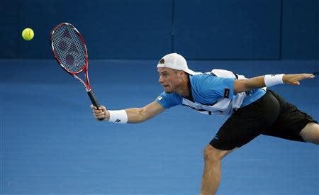 Lleyton Hewitt of Australia lunges for the ball during his men's final match against Roger Federer of Switzerland at the Brisbane International tennis tournament January 5, 2014. REUTERS/Jason Reed