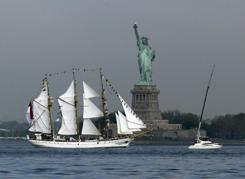 The KRI Dewaruci, from Indonesia, sails by the Statue Of Liberty, in New York, to participate in Fleet Week activities, Wednesday, May 23, 2012. This year's event marks the bicentennial of the War of 1812.  (AP Photo/Richard Drew)