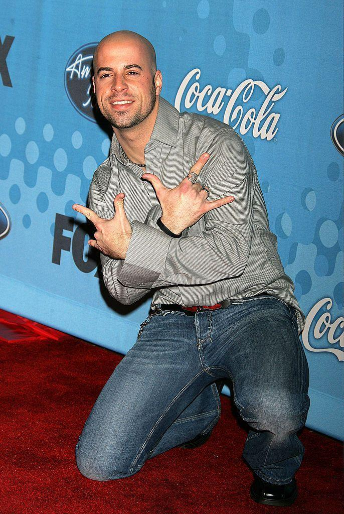 "<p>Despite coming in fourth place on the fifth season of <em>American Idol, </em>Chris Daughtry formed the band Daughtry, a group that's released five studio albums. The father of four made his acting debut in <em>CSI: New York</em> and has collaborated with artists like Timbaland and Lifehouse. He also tried his hand at the <a href=""https://www.countryliving.com/life/entertainment/a29711880/who-is-the-rottweiler-on-the-masked-singer/"" rel=""nofollow noopener"" target=""_blank"" data-ylk=""slk:outrageous Fox show,"" class=""link rapid-noclick-resp"">outrageous Fox show, </a><em><a href=""https://www.countryliving.com/life/entertainment/a29711880/who-is-the-rottweiler-on-the-masked-singer/"" rel=""nofollow noopener"" target=""_blank"" data-ylk=""slk:Masked Singer."" class=""link rapid-noclick-resp"">Masked Singer.</a></em></p>"