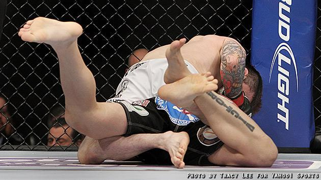 Scott Jorgensen takes John Albert's back during their fight at UFC on Fox 5. (Credit: Tracy Lee for Yahoo! Sports)