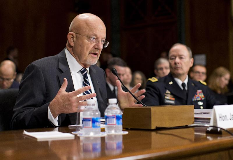 National Intelligence Director James Clapper, left, accompanied by National Security Agency Director Gen. Keith Alexander, testifies on Capitol Hill in Washington, Wednesday, Oct. 2, 2013, before the Senate Judiciary Committee oversight hearing on the Foreign Intelligence Surveillance Act. U.S. intelligence officials say the government shutdown is seriously damaging the intelligence community's ability to guard against threats. (AP Photo/ Evan Vucci)