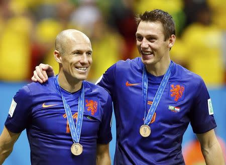 Arjen Robben (L) and Stefan de Vrij of the Netherlands celebrate after winning their 2014 World Cup third-place playoff against Brazil at the Brasilia national stadium in Brasilia July 12, 2014. REUTERS/Dominic Ebenbichler
