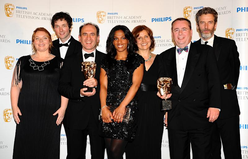 Cast of The Thick of It and Freema Agyeman with the Situation Comedy award received for The Thick of It at the BAFTA television awards at the London Palladium.