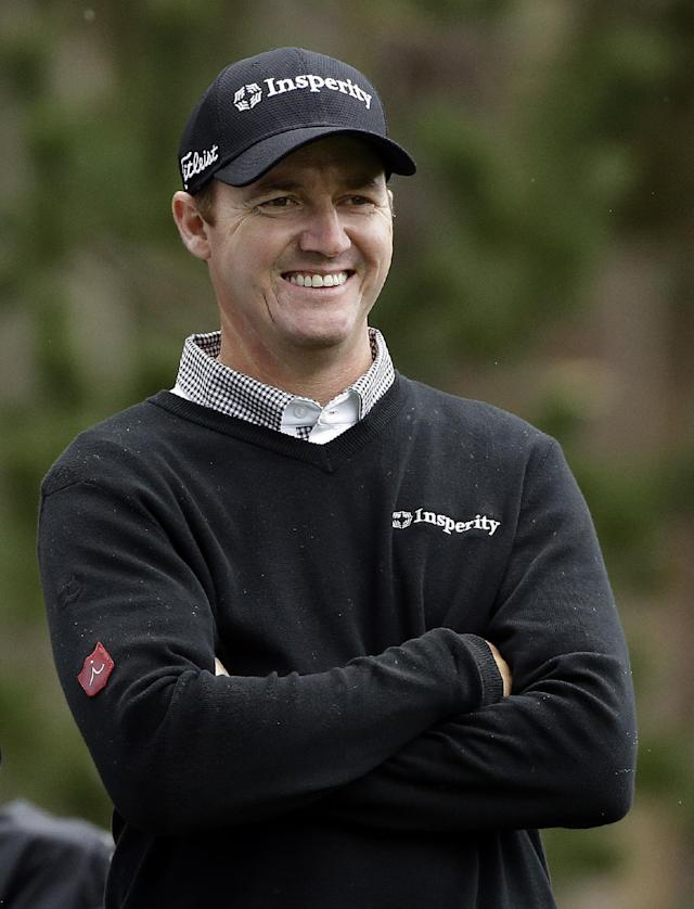 Jimmy Walker smiles as he waits to hit off the seventh tee on Friday, Feb. 7, 2014, during the second round of the AT&T Pebble Beach Pro-Am golf tournament on the Spyglass Hill Golf Course in Pebble Beach, Calif. (AP Photo/Ben Margot)