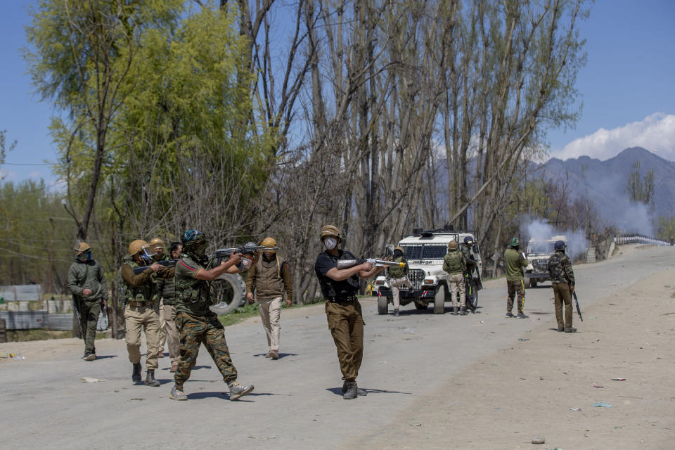 Indian policemen fire pellets and teargas shells at Kashmiri villagers during a protest near the site of a gunbattle in Pulwama, south of Srinagar, Indian controlled Kashmir, Friday, April 2, 2021. Anti-India protests and clashes have erupted between government forces and locals who thronged a village in disputed Kashmir following a gunbattle that killed three suspected militants. Police say the gunfight on Friday erupted shortly after scores of counterinsurgency police and soldiers launched an operation based on tip about presence of militants in a village in southern Pulwama district. (AP Photo/ Dar Yasin)