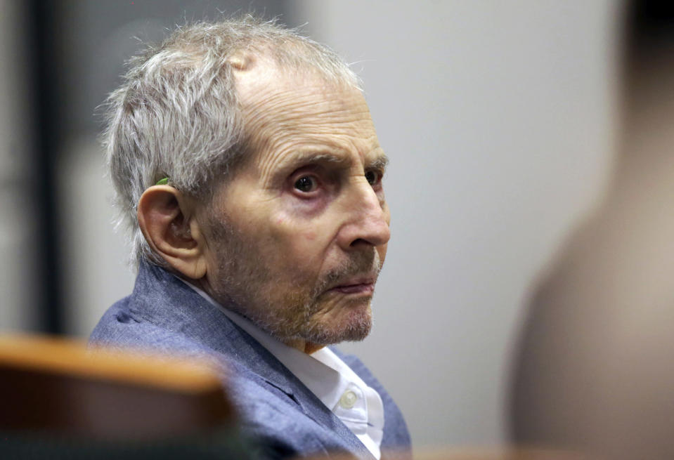 FILE - In this March 10, 2020, file photo, real estate heir Robert Durst looks over during his murder trial in Los Angeles. A judge on Monday, June 14, 2021, ordered that the murder trial of the multimillionaire real estate heir will continue, despite defense requests for a delay because he's in too much pain. Durst's lawyers argued that he was in such pain from a urinary tract infection and other undiagnosed issues that he couldn't even stand up to to dress for court. (AP Photo/Alex Gallardo, Pool, File)