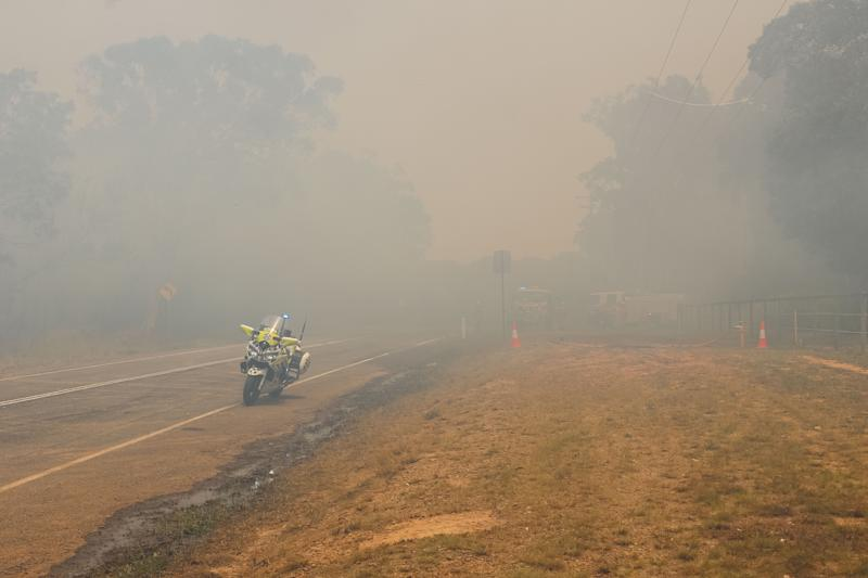 Thick smoke along Lake Cooroibah Road and Jirrimah Crescent in Cooroibah in Noosa Shire on Saturday.
