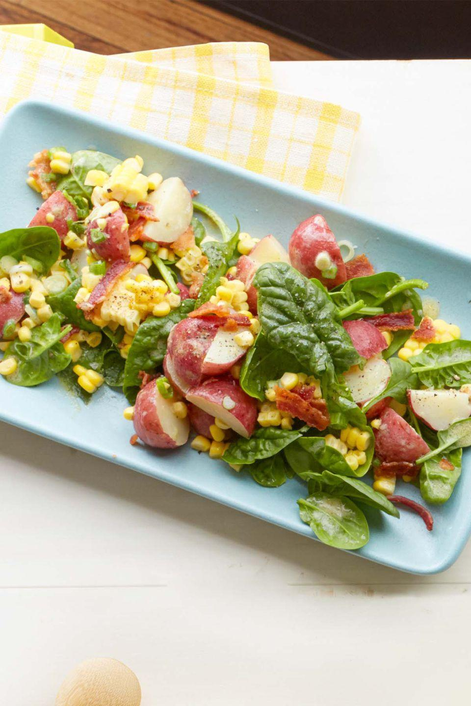 "<p>This simple summer salad is fresh and filling - a.k.a. all you could ever want for a hot day.</p><p><em><a href=""https://www.womansday.com/food-recipes/food-drinks/recipes/a54827/spinach-potato-and-corn-salad-recipe/"" rel=""nofollow noopener"" target=""_blank"" data-ylk=""slk:Get the recipe for Spinach, Potato, and Corn Salad."" class=""link rapid-noclick-resp"">Get the recipe for Spinach, Potato, and Corn Salad.</a></em> </p>"